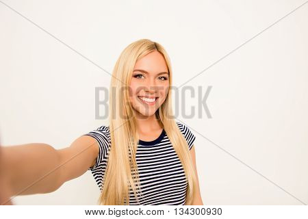 Pretty Young Woman Making  Selfie On White Background