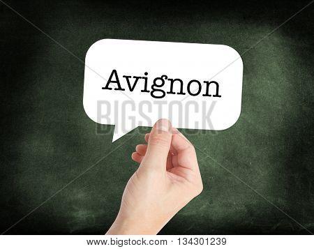 Avignon written in a speech bubble