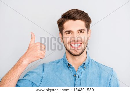 Happy Man With Beaming Smile Showing Thumb Up
