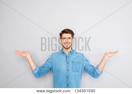 Young Happy Man Gesturing With Hands And Showing Balance