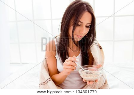 Atrractive Woman Covering With Plaid Eating Porridge