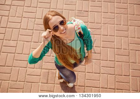 Top View Portrait Of Young Cheerful Tourist In Spectacles