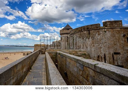 Scenic view of Saint-Malo fort and dramatic clouds