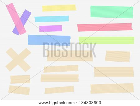 Set of colorful and different size masking, sticky, tapes are stuck on white background.