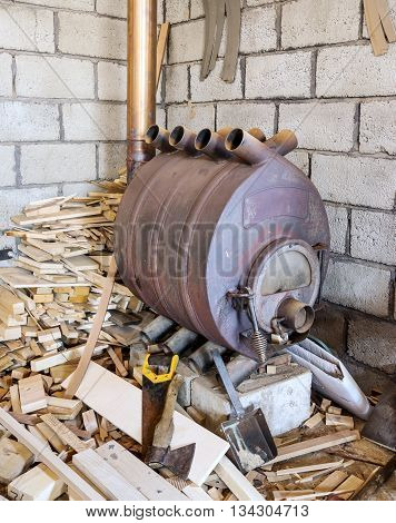 Modern wood burning cast iron oven in the boiler room for heating of rooms