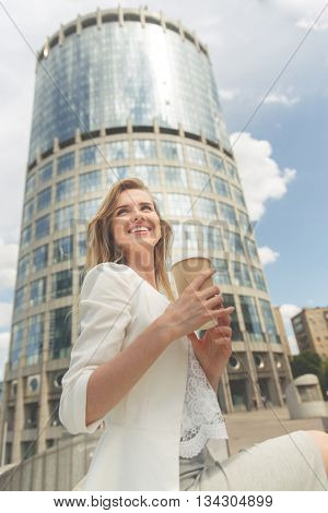 Beautiful Woman with Coffee to Go in the City.