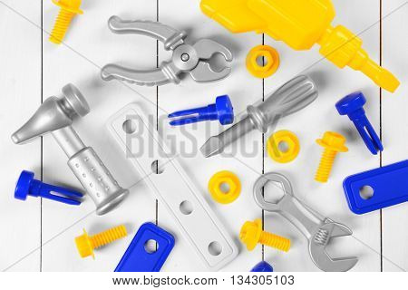 Toy set for child on wooden background