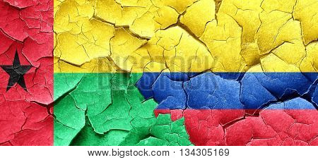 Guinea bissau flag with Colombia flag on a grunge cracked wall