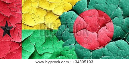 Guinea bissau flag with Bangladesh flag on a grunge cracked wall