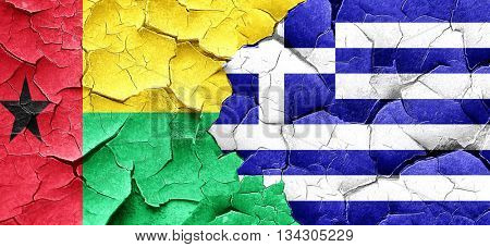 Guinea bissau flag with Greece flag on a grunge cracked wall