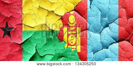 Guinea bissau flag with Mongolia flag on a grunge cracked wall