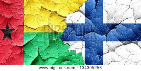 Guinea bissau flag with Finland flag on a grunge cracked wall