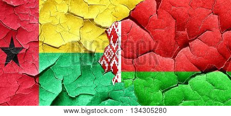 Guinea bissau flag with Belarus flag on a grunge cracked wall