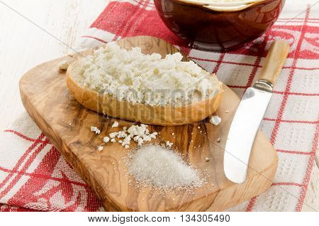 bun with home made cottage cheese and sugar on wooden board