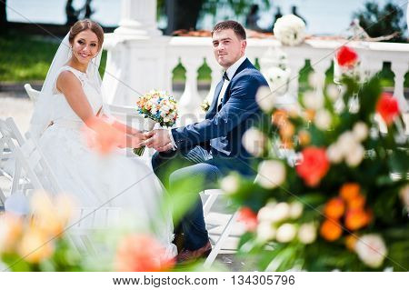 Happy Fashionable Wedding Couple On Wedding Ceremony Of Registration