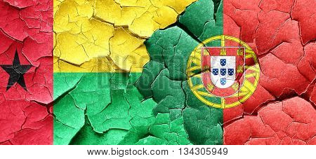 Guinea bissau flag with Portugal flag on a grunge cracked wall
