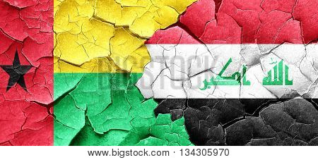 Guinea bissau flag with Iraq flag on a grunge cracked wall