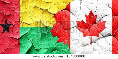 Guinea bissau flag with Canada flag on a grunge cracked wall