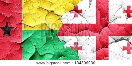 Guinea bissau flag with Georgia flag on a grunge cracked wall
