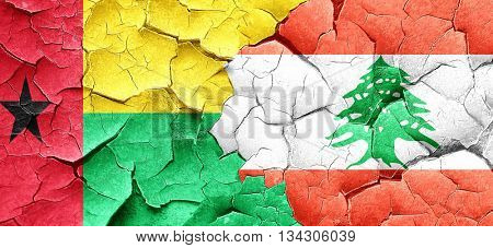 Guinea bissau flag with Lebanon flag on a grunge cracked wall