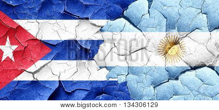 Cuba flag with Argentine flag on a grunge cracked wall