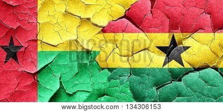 Guinea bissau flag with Ghana flag on a grunge cracked wall