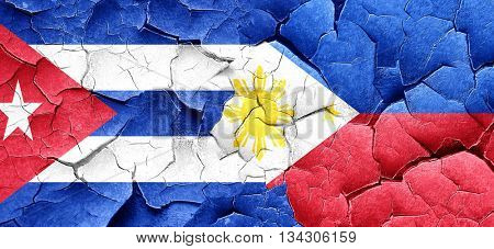 Cuba flag with Philippines flag on a grunge cracked wall