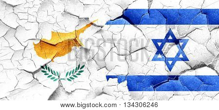 Cyprus flag with Israel flag on a grunge cracked wall