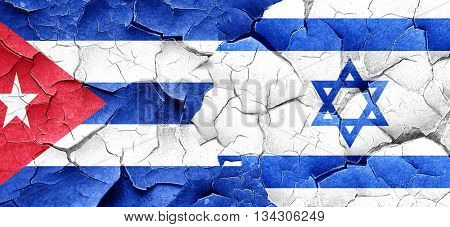 Cuba flag with Israel flag on a grunge cracked wall