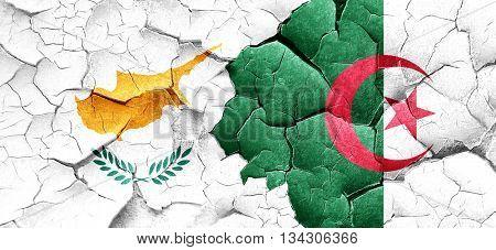 Cyprus flag with Algeria flag on a grunge cracked wall