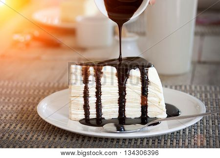Pour Chocolate Sauce Into Cheesecake