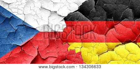 czechoslovakia flag with Germany flag on a grunge cracked wall