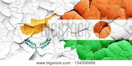 Cyprus flag with Niger flag on a grunge cracked wall