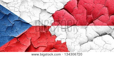 czechoslovakia flag with Indonesia flag on a grunge cracked wall