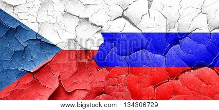czechoslovakia flag with Russia flag on a grunge cracked wall