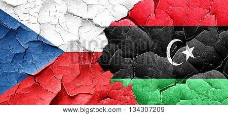 czechoslovakia flag with Libya flag on a grunge cracked wall