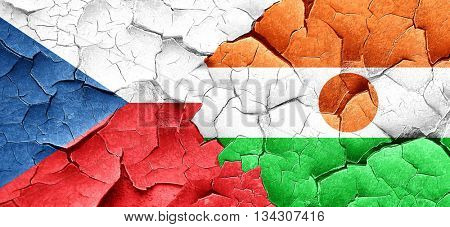 czechoslovakia flag with Niger flag on a grunge cracked wall