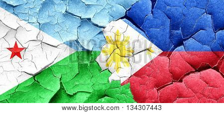 Djibouti flag with Philippines flag on a grunge cracked wall