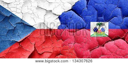 czechoslovakia flag with Haiti flag on a grunge cracked wall