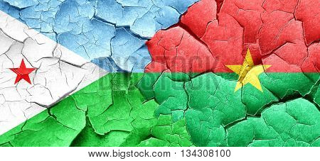 Djibouti flag with Burkina Faso flag on a grunge cracked wall