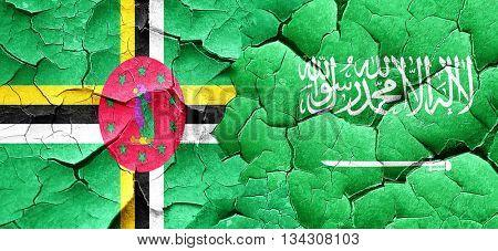 Dominica flag with Saudi Arabia flag on a grunge cracked wall