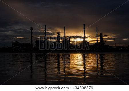 Silhouette Oil refinery factory in the morning.