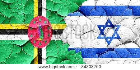 Dominica flag with Israel flag on a grunge cracked wall