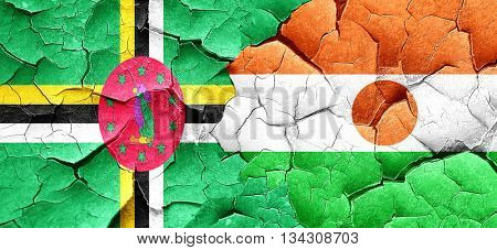 Dominica flag with Niger flag on a grunge cracked wall