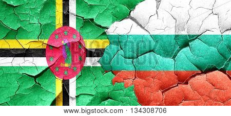 Dominica flag with Bulgaria flag on a grunge cracked wall