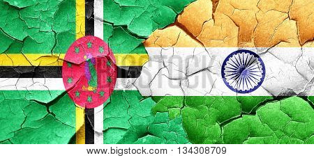 Dominica flag with India flag on a grunge cracked wall