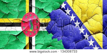 Dominica flag with Bosnia and Herzegovina flag on a grunge crack