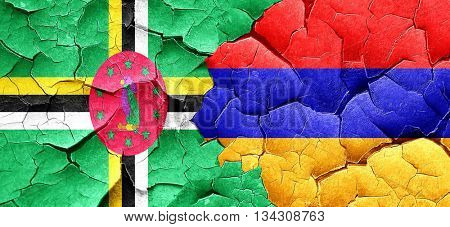 Dominica flag with Armenia flag on a grunge cracked wall