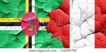 Dominica flag with Peru flag on a grunge cracked wall