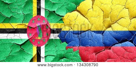 Dominica flag with Colombia flag on a grunge cracked wall